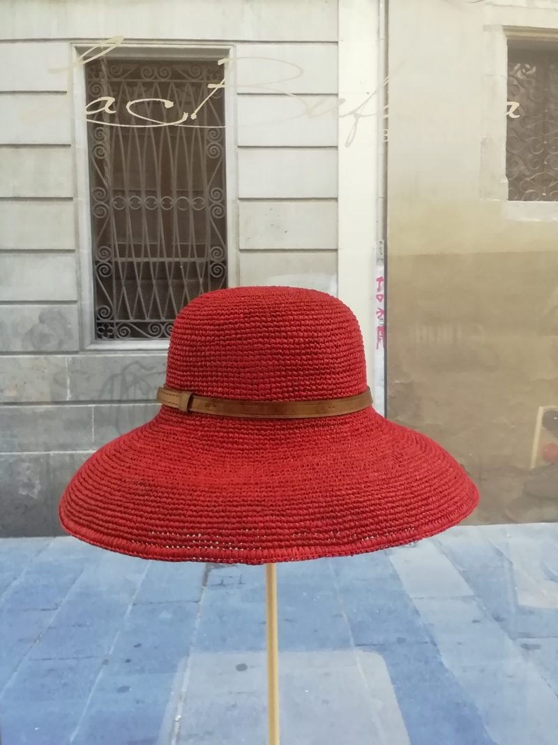 Pamela cloche hat by Ibeliv. Handmade in red raphia with leather band. Foldable hat