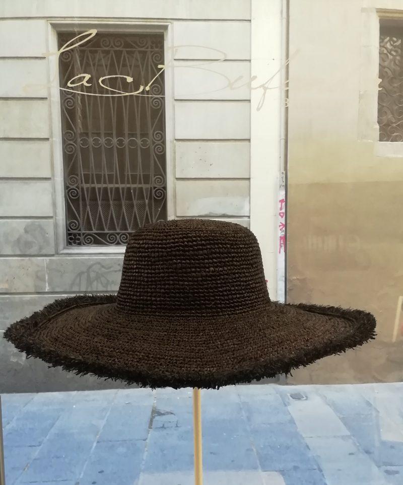 Pamela hat by Ibeliv. Handmade in black raphya with fringe
