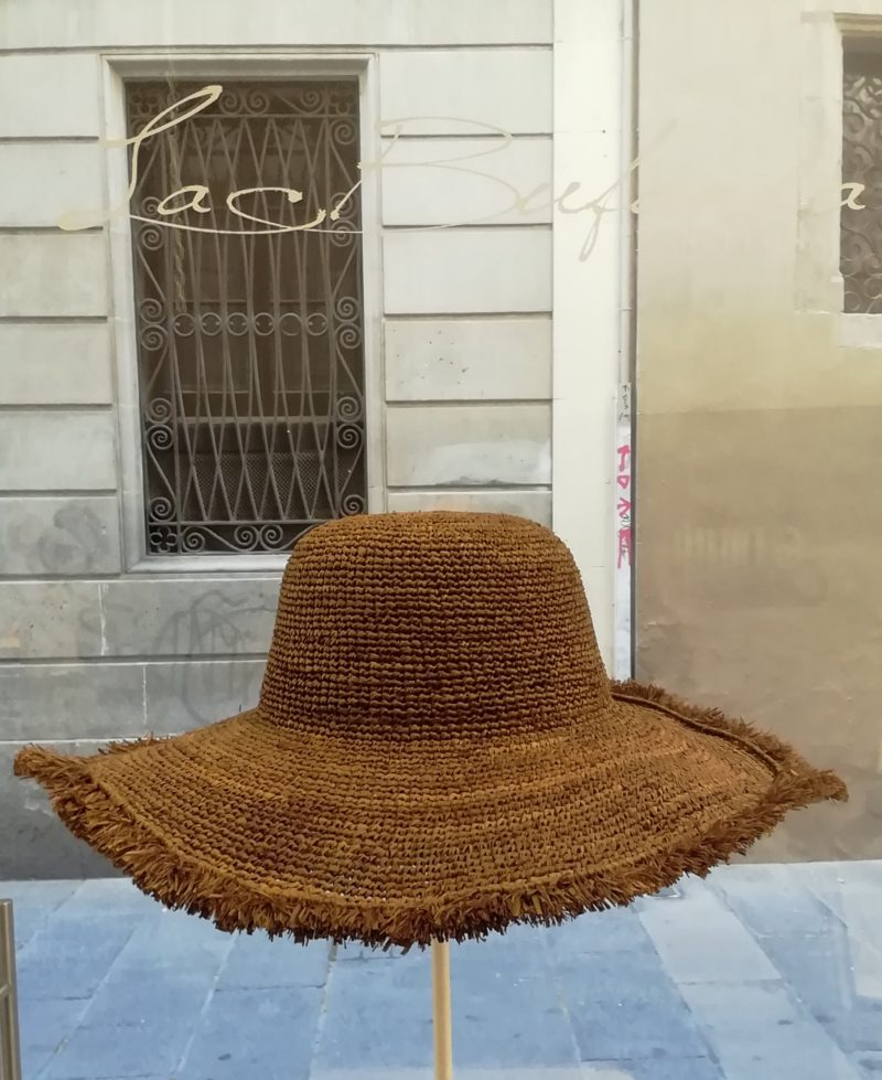 Pamela hat by Ibeliv. Handmade in brown raphya with fringe