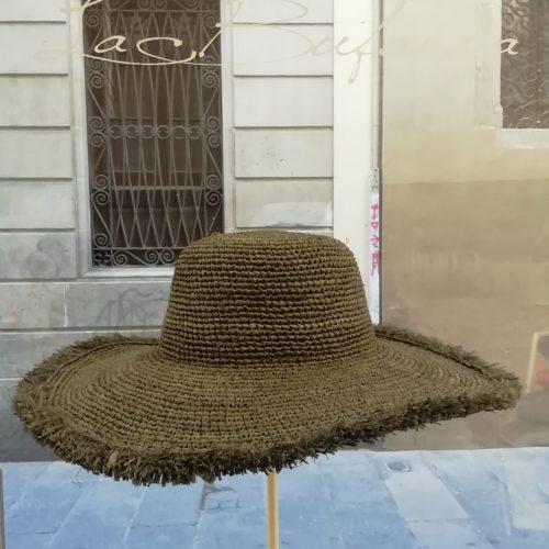 Pamela hat by Ibeliv. Handmade in grey raphya with fringe