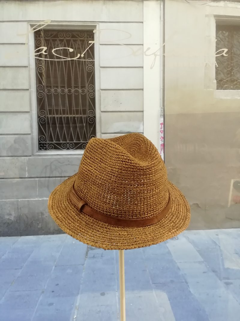 Fedora hat by Ibeliv. Handmade in dark natural raphia with leather band. Foldable hat