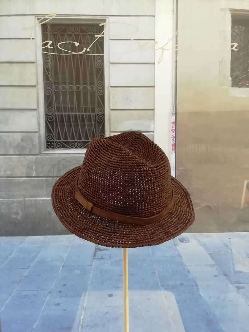 Fedora hat by Ibeliv. Handmade in brown raphia with leather band. Foldable hat