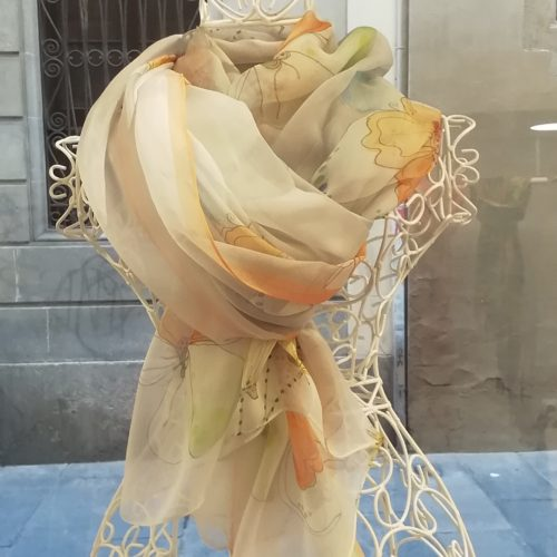 Silk organza scarf. Elegant design with flowes. Orange pastel colours