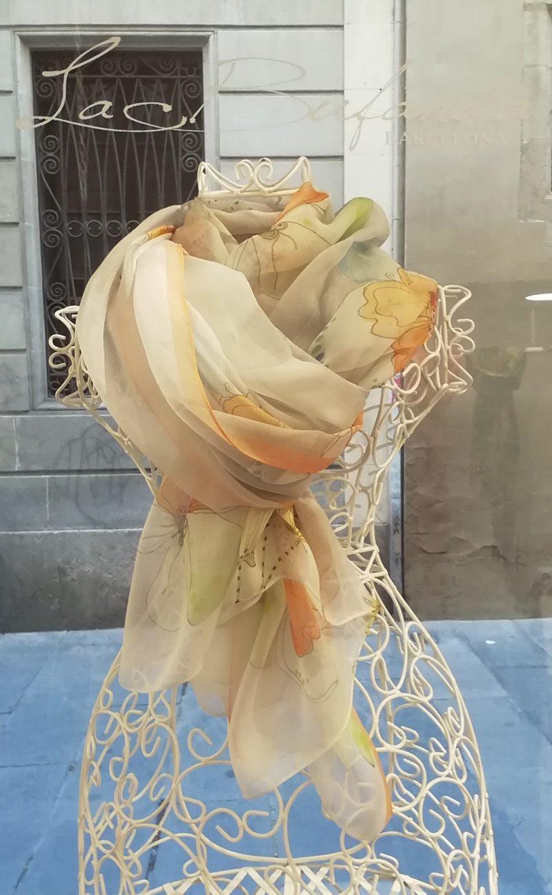 Silk organza scarf. Elegant design with flowes. Orange pastel colours