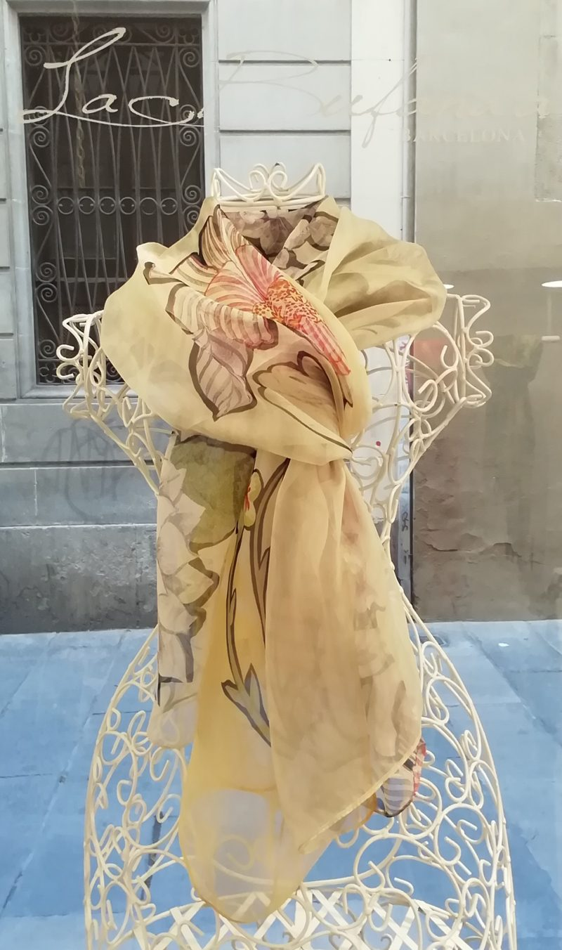 Silk organza scarf. Elegant design with flowes. Yellow pastel colours